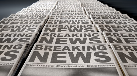 36164776 - a long row of folded newspapers at the end of a press run with a generic headline that reads breaking news on the front page on an isolated white background